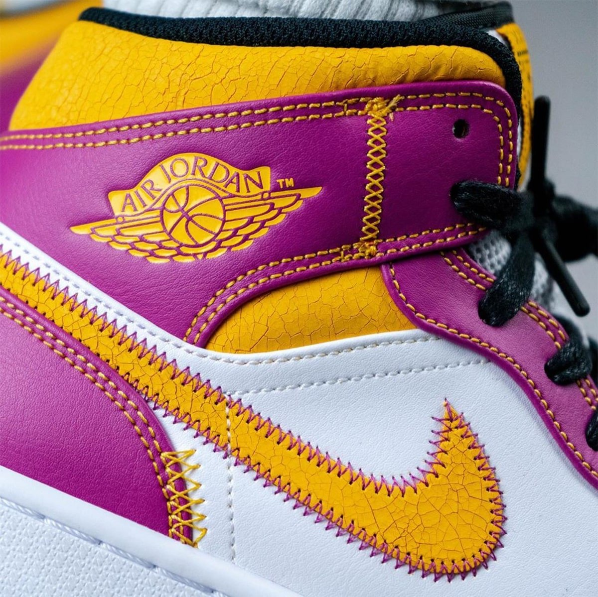 "Air Jordan 1 Mid ""Familia"" wings logo"