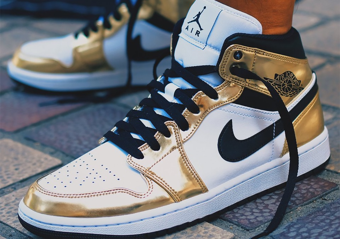 Air Jordan 1 Mid Metallic Gold Tongue Jumpman Logo