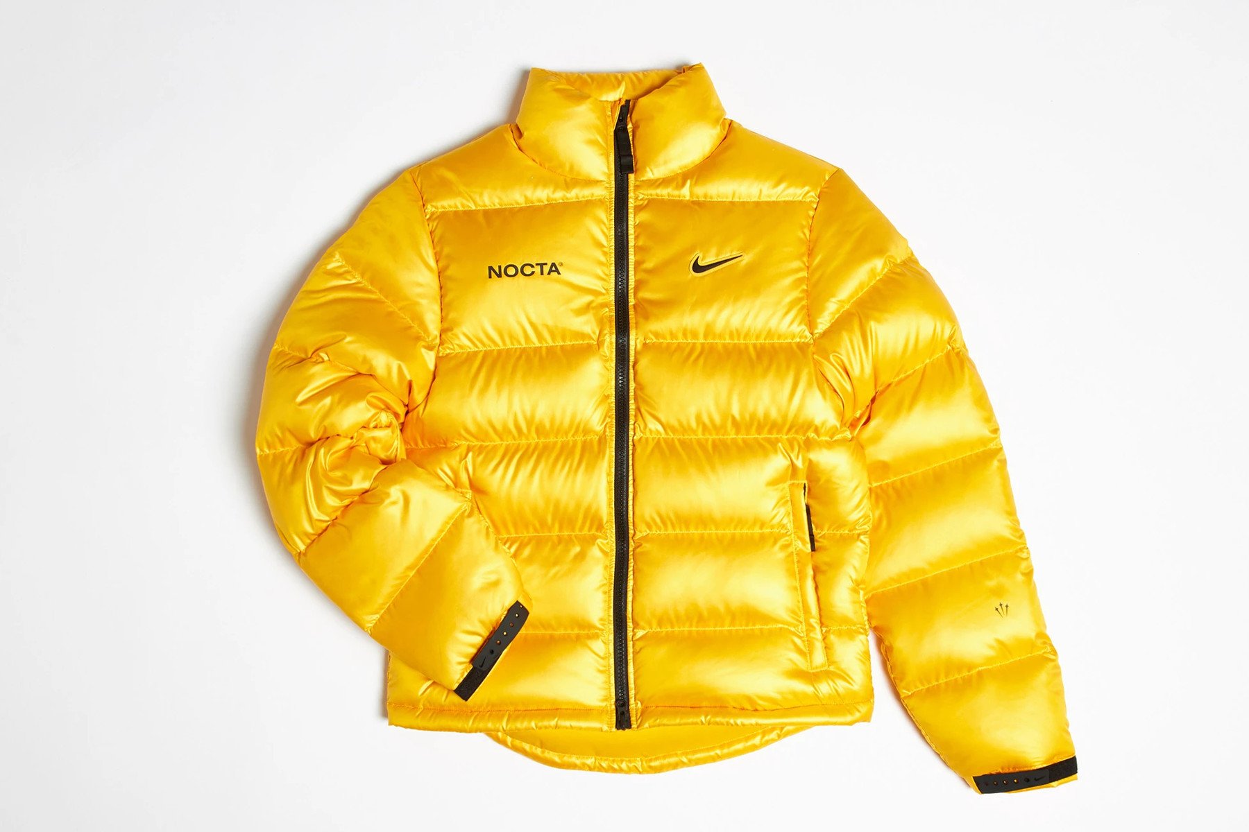 NOCTA x Nike Puffer Jacket University Gold