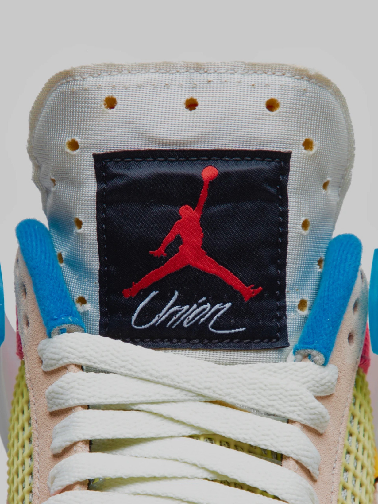 Union LA x Air Jordan 4 Guava Ice togue branding